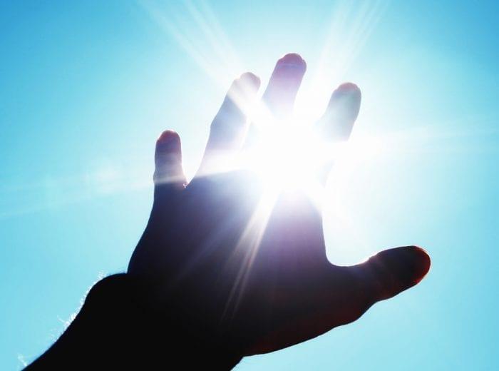 light shining through fingers