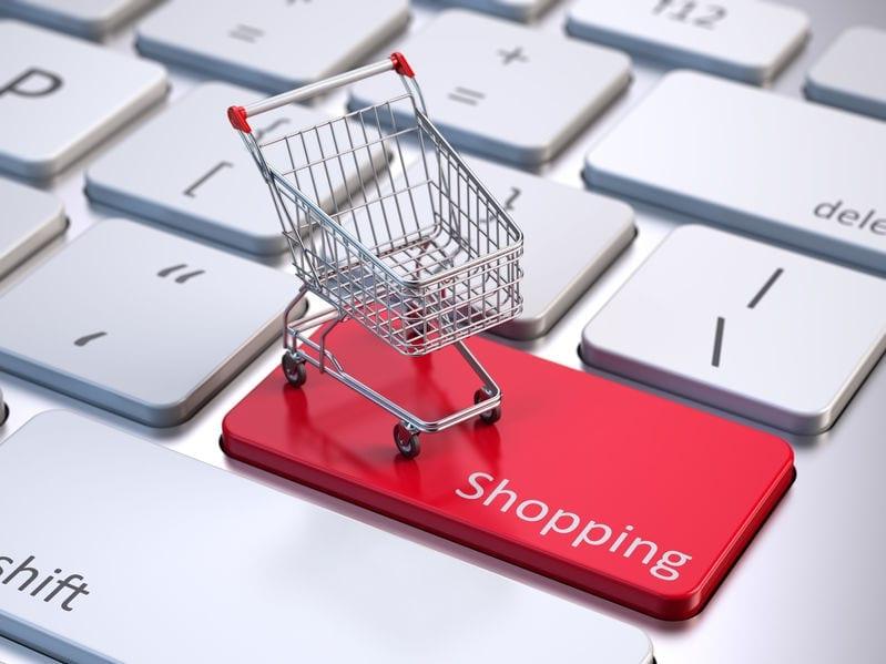 mini shopping cart on computer keyboard