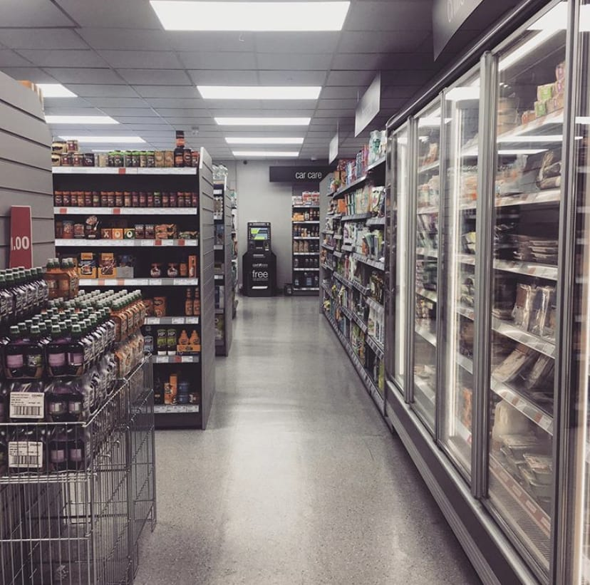 inside of a packed supermarket