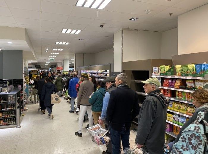 people queue at waitrose during coronavirus pandemic