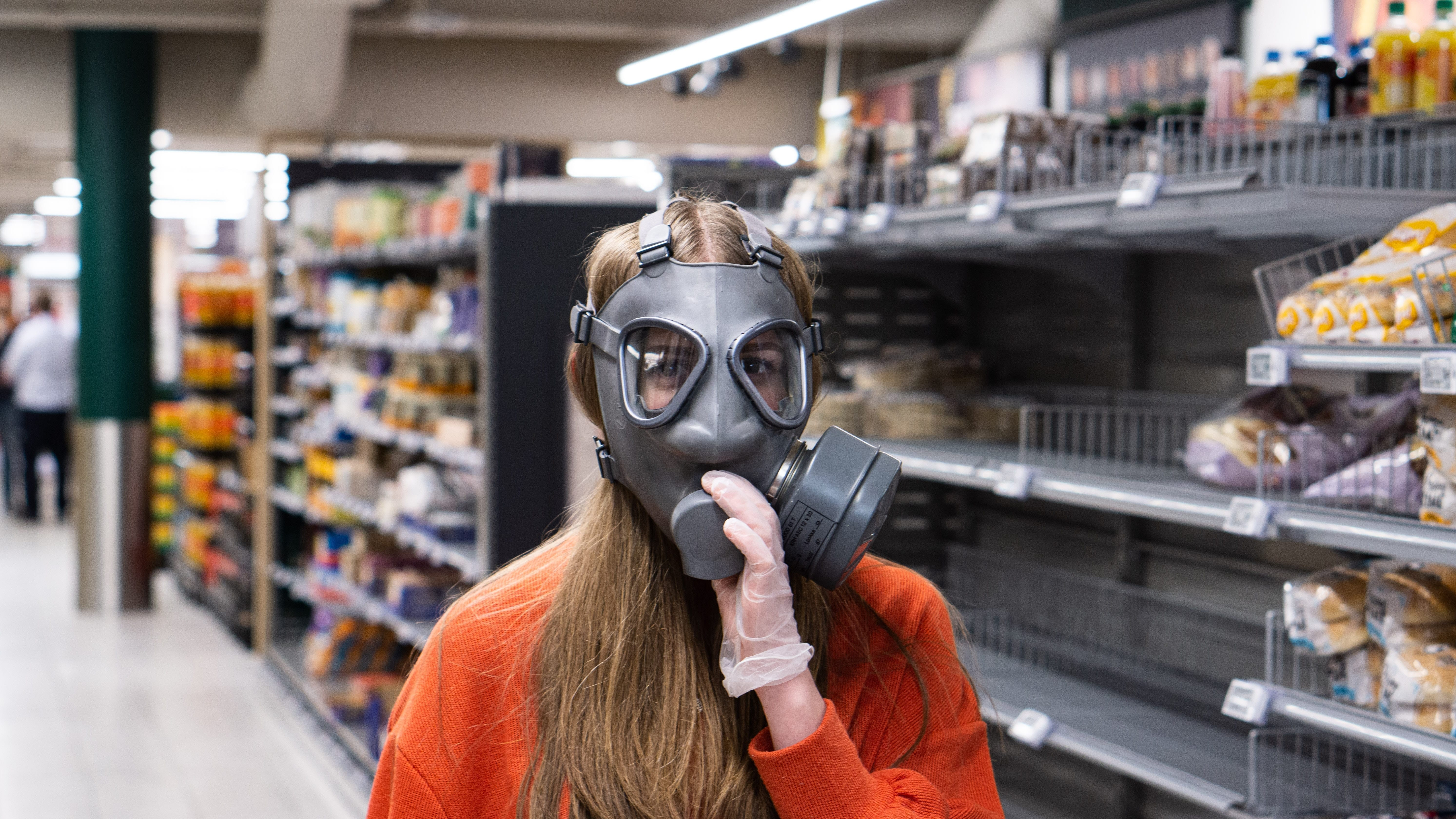 woman with mask on in supermarket