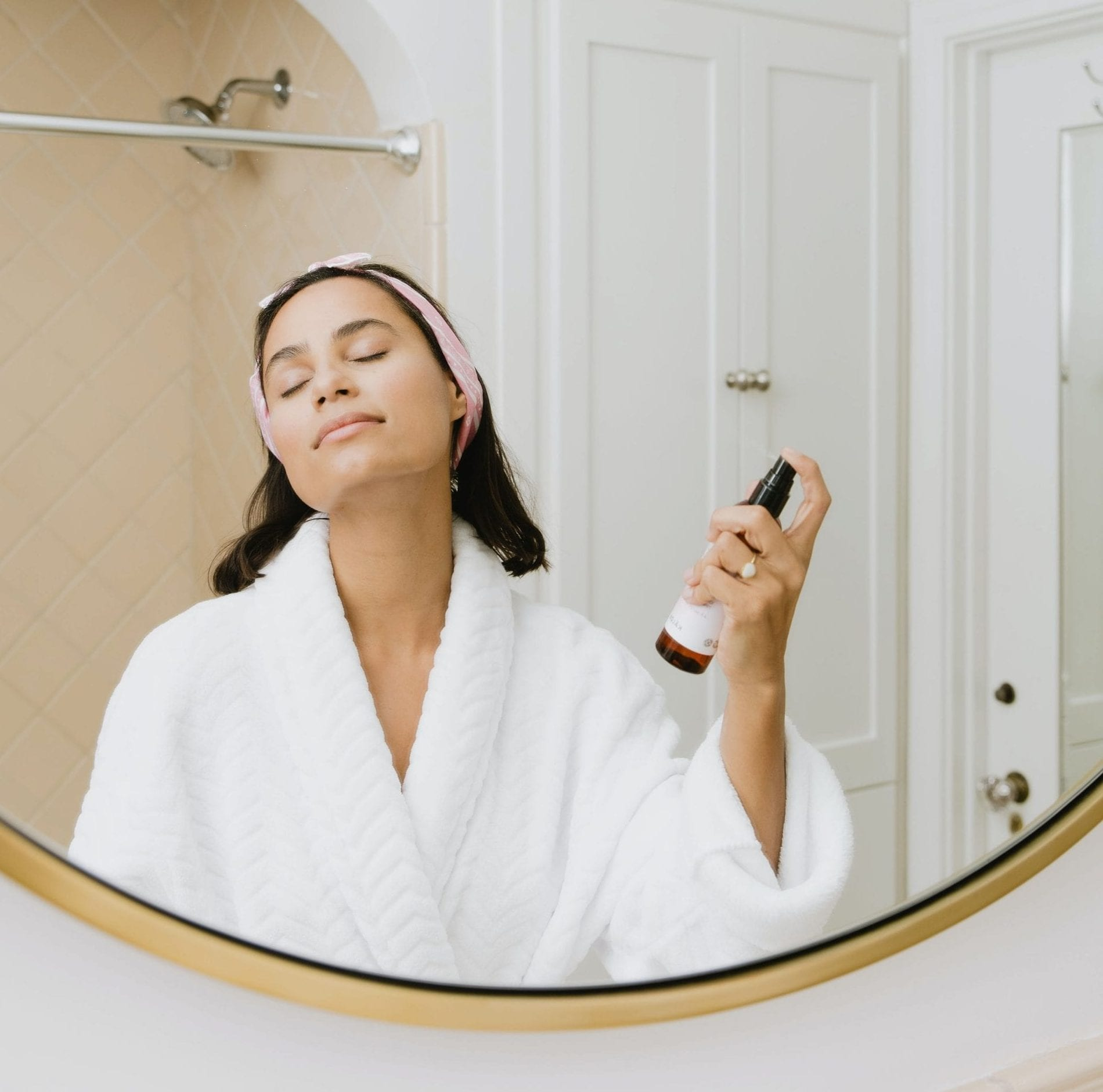 woman applying beauty product