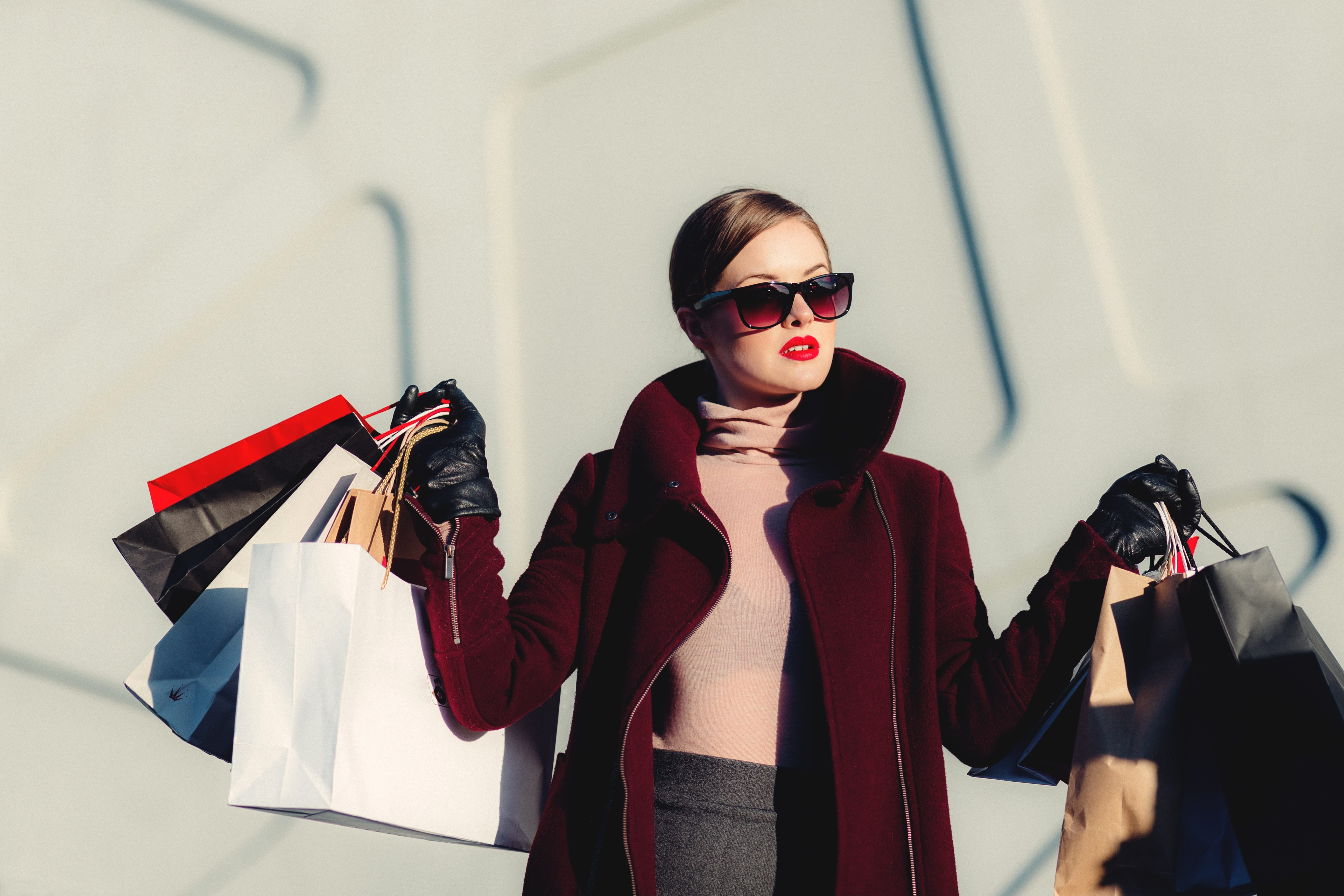 shopper with bags of beauty products