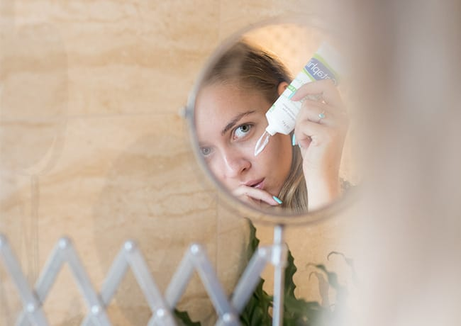 woman applying anti ageing cream