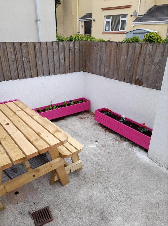 outdoor office area with flowers